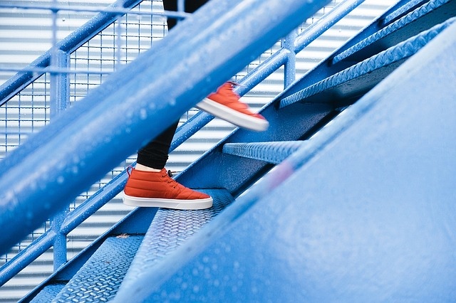 red shoes climbing stairs