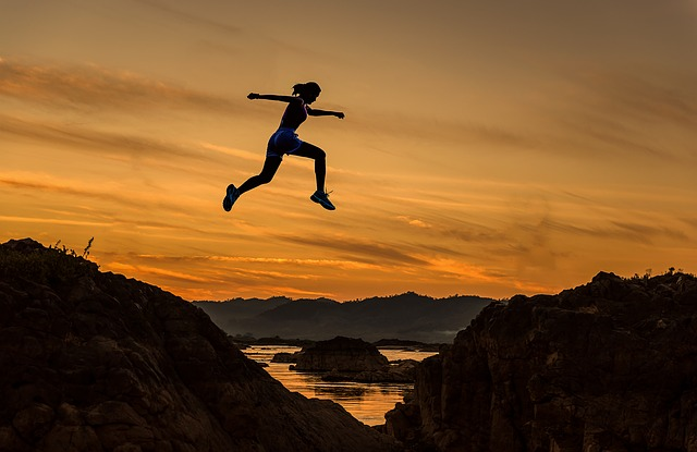person leaping across the mountains