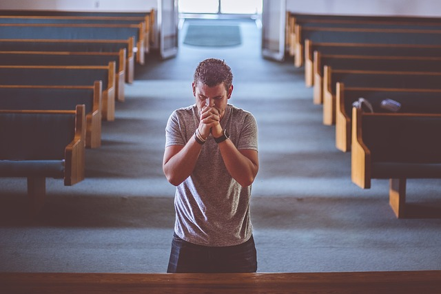 Man praying alone in a church