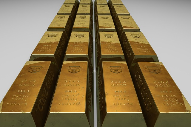 16 gold bars laid on the ground