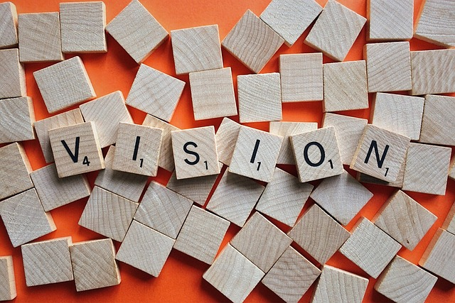 Scrabble tiles with the word vision spelt out